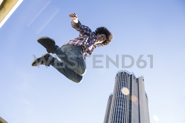 Young man jumping in the air - ABZF01805
