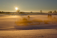 Germany, Gebrazhofen, sunrise over hazy winter landscape - SIEF07271