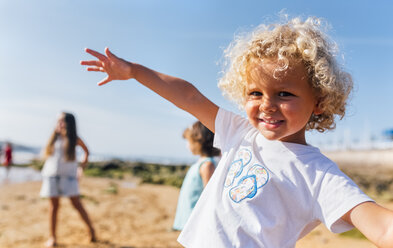 Portrait of happy little boy on the beach - MGOF02835