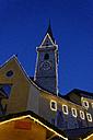 Italy, Alto Adige, Bruneck, church tower and Chritsmas market at night - LBF01546