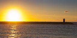 Netherlands, The Hague, Scheveningen, lighthouse at sunset - WIF03392