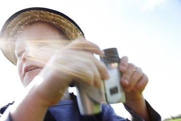 Boy with binoculars outdoors - FSF00681