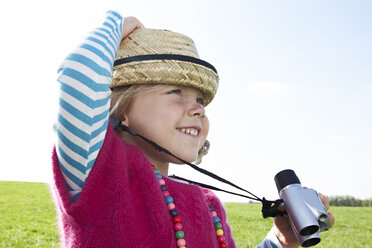 Girl with binoculars on meadow - FSF00684