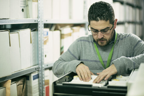 Man searching for files in an archive - JASF01508