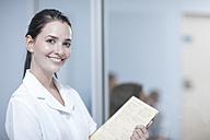 Nurse holding patient's record, portrait - ZEF12605