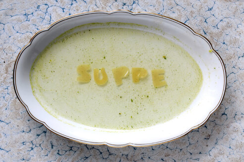Word 'soup' written with pasta on  plate with soup - HSTF00043