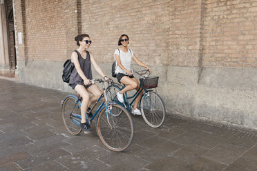 Two young women riding bicycle in the city - ALBF00085