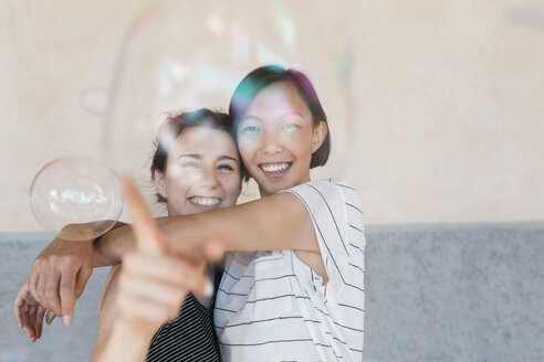 Two young women playing with soap bubbles - ALBF00121