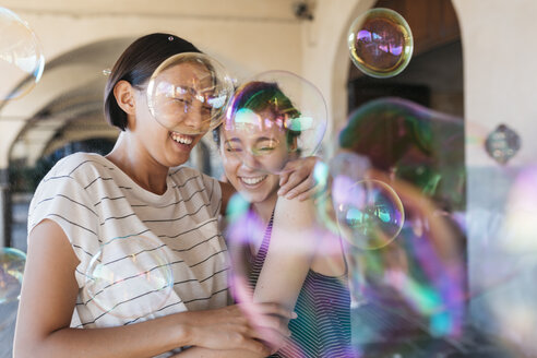 Two young women playing with soap bubbles - ALBF00124