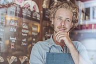 Portrait of coffee roaster in his shop thinking - KNSF00883