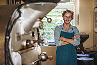 Portrait of confident coffee roaster in his shop - KNSF00892