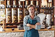 Portrait of confident coffee roaster in his shop - KNSF00901