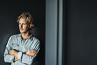 Portrait of confident blond man wearing white shirt - KNSF00946