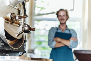 Machine and man in coffee roastery - KNSF00955