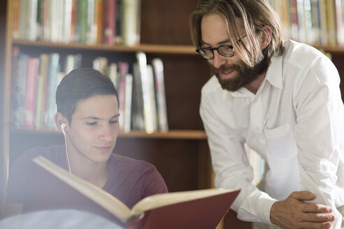 High school student in library with librarian - ZEF12671
