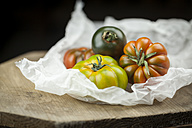 Various Oxheart Tomatoes on paper - JUNF00810
