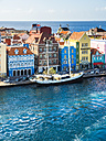 Curacao, Willemstad, Punda, schooner and colorful houses at waterfront promenade - AMF05233