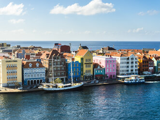 Curacao, Willemstad, Punda, schooner and colorful houses at waterfront promenade - AMF05236