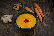 Bowl of carrot curcuma soup with ginger and chili - LVF05849