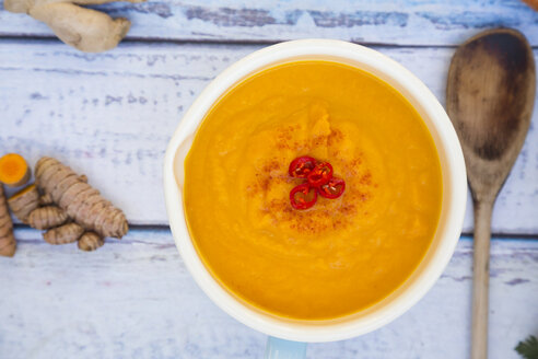Bowl of carrot curcuma soup with ginger and chili - LVF05852