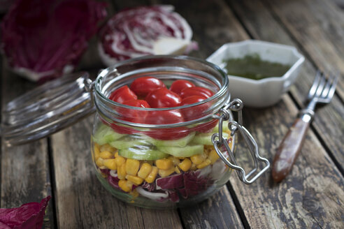Preserving jar of salad with different vegetables - YFF00635