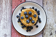 Dish with pile of pancakes and blueberries with maple sirup - SARF03165