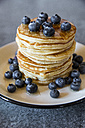 Dish with pile of pancakes and blueberries with maple sirup - SARF03168