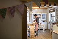 Man standing in kitchen, preparing cake dough - HAPF01334
