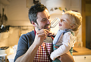 Father and baby boy in kitchen baking a cake - HAPF01337