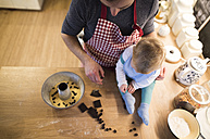 Father and baby boy in kitchen baking a cake - HAPF01343