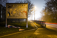Billboard with destroyed advertising at night - JATF00946