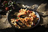 Spaghetti Frutti di Mare with leaf spinach lettuce dish - MAEF12114