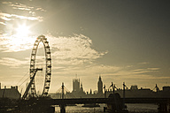 UK, London, skyline with London Eye and Big Ben in backlight - NGF00379