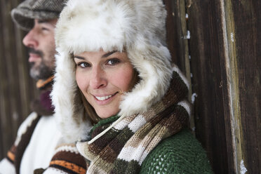 Portrait of smiling woman wearing fur cap in winter - FSF00722