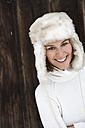 Portrait of smiling woman wearing fur cap in winter - FSF00731