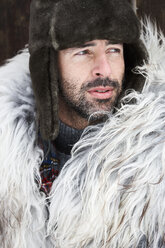 Portrait of man wearing fur cap in winter - FSF00734