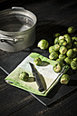 Brussel sprouts, cloth and kitchen knife on slate - MAEF12125