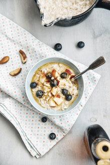 Vegan coconut milk porridge with blueberries, apple, brazil nuts and cinnamon - IPF00356
