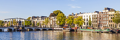 Netherlands, Amsterdam, view to Magere Brug and row of historical houses at Amstel River - WDF03881