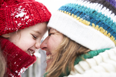 Mother and daughter having fun in winter - FSF00751