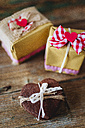 Stack of heart-shaped chocolate shortbreads tied with lace and two gift boxes - GIOF01765