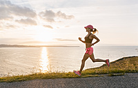 Young woman running at the sea - MGOF02890
