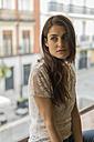 Portrait of woman in front of window - KKAF00378