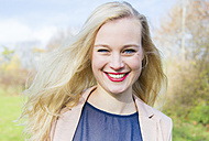 Portrait of smiling young blonde woman outdoors - NGF00384