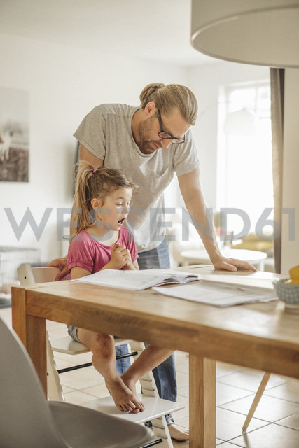 Father checking homework of his daughter - JOSF00479