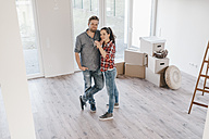 Couple moving house, woman holding keys of new home - JOSF00541