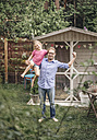 Father carrying daughter in garden - JOSF00610