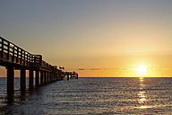Germany, Boltenhagen, sea bridge at sunset - PUF00583