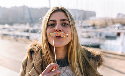 Portrait of teenage girl with toy moustache - MGOF02943
