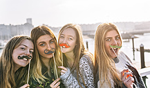 Portrait of four friends with toy moustaches - MGOF02964